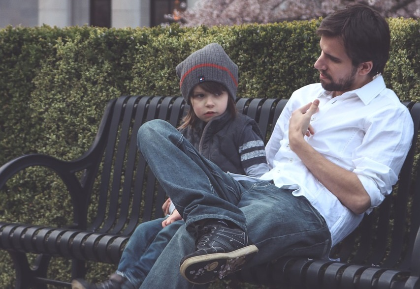 Father and child on a bench